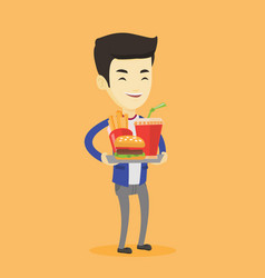 Man holding tray full of fast food vector