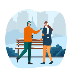 cute couple are walking in a winter park vector image