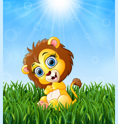 Cartoon baby lion sitting in the grass on a backgr vector