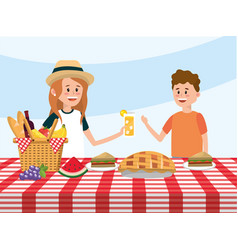 fun girl and boy in the table with basket vector image