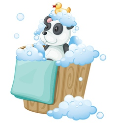 A panda toy and a rubber duck inside a pail vector image