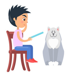 boy on chair reads from tablet beside white dog vector image