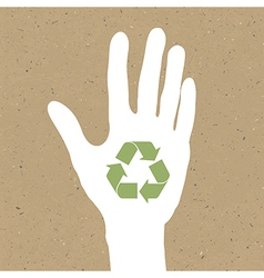 Reuse sign on hand silhouette on recycled paper E vector image vector image