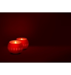 two candles red dark background vector image