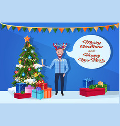 man holding gift box champagne deer horns hat chat vector image