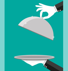 Hands of waiter holding empty silver cloche vector