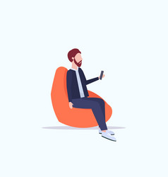 Man sitting in bean bag armchair businessman vector