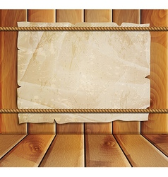 Old paper on a wooden background vector image