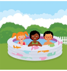 Group of children in an inflatable pool vector