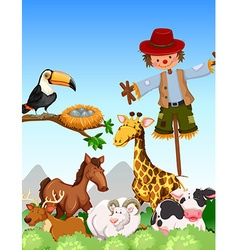 Many wild animals and scarecrow in thefield vector