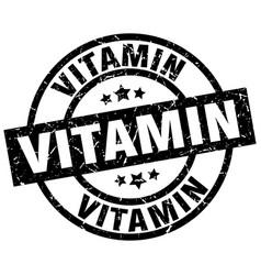 Vitamin round grunge black stamp vector
