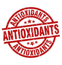 Antioxidants round red grunge stamp vector