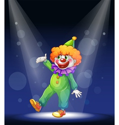 A clown at the center of the stage with a vector image