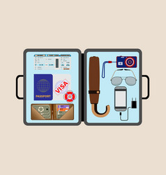 Necessary things for travel in an open briefcase vector