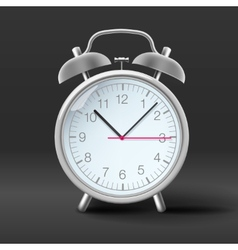 Vintage alarm clock on grey background vector image