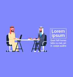 arabic business men sitting at office desk working vector image