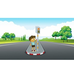 Boy using signal to cross road vector