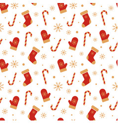 Christmas pattern with mittens xmas socks candy vector