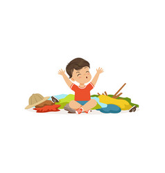 funny little bully boy sitting among scattered vector image