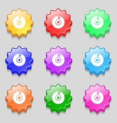 CD or DVD icon sign Symbols on nine wavy colourful vector image