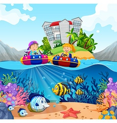 Two kids riding on rubber boats in ocean vector image