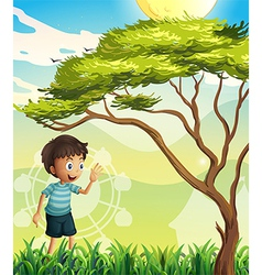 A happy boy near the tree vector image