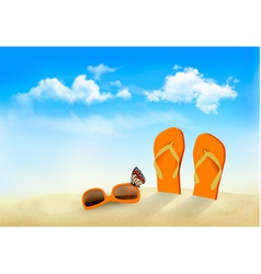 Flip flops sunglasses and a butterfly on a beach vector image