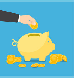 hand puts a coin into piggy bank vector image