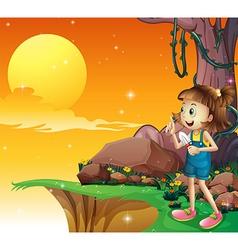 A young girl near the cliff holding a small shovel vector