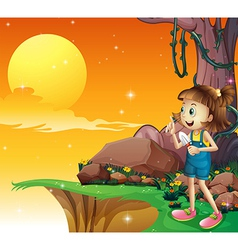 A young girl near the cliff holding small shovel vector