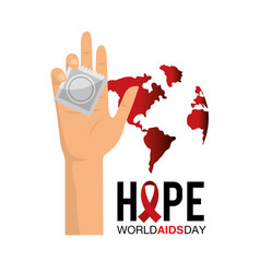 Condom in the hand to world aids day vector