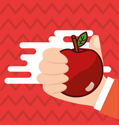 hand holding apple fresh colored background vector image