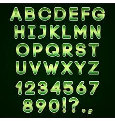 Golden and green neon alphabet on dark background vector