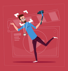 man holding action camera modern video blogger vector image vector image