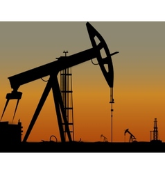 Image of oil derricks on the ground vector