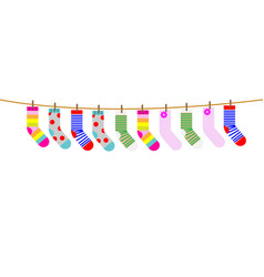 A set of children socks are dried on rope vector