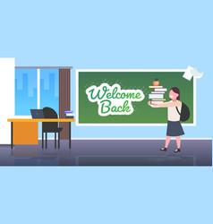 schoolgirl standing in front chalk board vector image