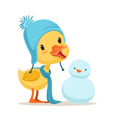 Little yellow duck chick wearing blue knitted hat vector