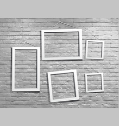 White mock up photo frame with brick wall loft vector