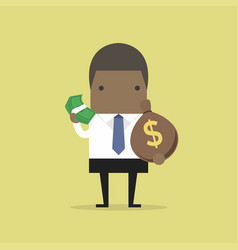 african businessman holds in hand money vector image vector image