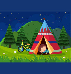 boy camping out in the park vector image