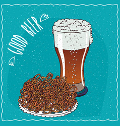 Pile of pretzels with glass of beer vector