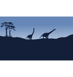 Silhouette of argentinosaurus on the hill vector image