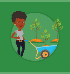 woman pushing wheelbarrow with plant vector image