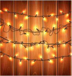christmas lights realistic garland on wood vector image