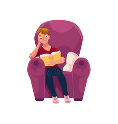 young man reading a book in comfortable armchair vector image