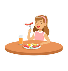 Cute girl eating sausage while having breakfast in vector