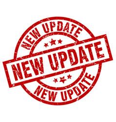 New update round red grunge stamp vector