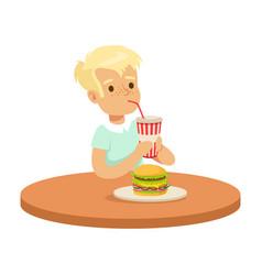 cute boy drinking a soda through a straw and vector image vector image