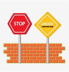 Under construction and stop signs with bricks wall vector